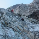 Max guides Saravie through a steep section on the slabs